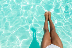 Woman relaxing in a pool Stock Images