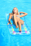Woman Relaxing in a pool Royalty Free Stock Photo