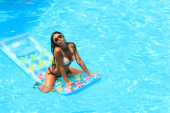 Woman Relaxing in a pool Royalty Free Stock Image