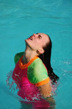 Woman relaxing in pool Stock Photography