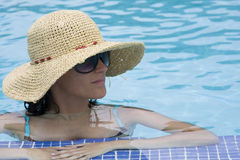 Woman relaxing in the pool Royalty Free Stock Photography