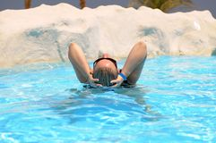 Woman relaxing in pool Royalty Free Stock Images