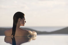 A woman relaxing in a pool Royalty Free Stock Photo