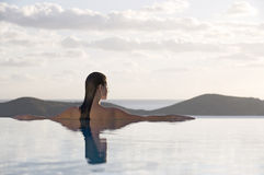 A woman relaxing in a pool Royalty Free Stock Image