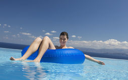 A woman relaxing in a pool Royalty Free Stock Images