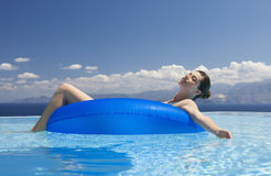 A woman relaxing in a pool Stock Image