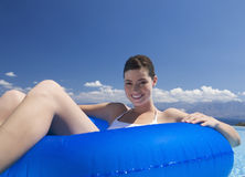 A woman relaxing in a pool Stock Photos