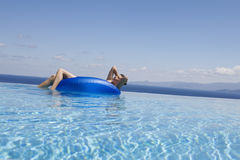 A woman relaxing in a pool Stock Photo