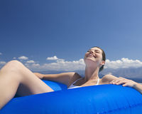A woman relaxing in a pool Royalty Free Stock Photos
