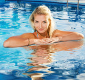 Woman relaxing in a pool Stock Photo