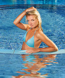 Woman relaxing in a pool Royalty Free Stock Images
