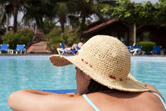 Woman relaxing at the pool Royalty Free Stock Photos