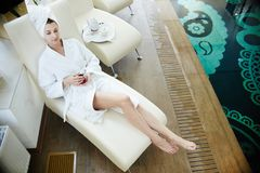 Woman Relaxing by Pool in Bathrobe royalty free stock images
