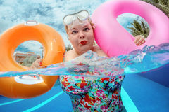 Woman relaxing in the pool Royalty Free Stock Images