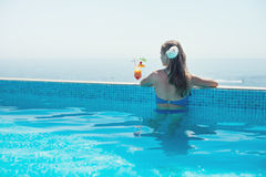 Woman relaxing at the pool Royalty Free Stock Image
