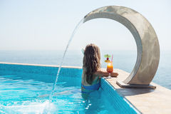 Woman relaxing at the pool Stock Image