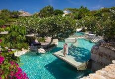 Woman relaxing in pool of luxury resort. Beautiful woman relaxing in pool of luxury resort Stock Image
