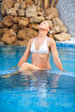 Woman relaxing in the pool at Spa center Royalty Free Stock Photo