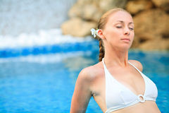 Woman relaxing in the pool at Spa center Royalty Free Stock Photos