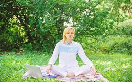Woman relaxing practicing meditation. Reasons you should meditate every day. Find minute to relax. Clear your mind. Girl. Meditate on rug green grass meadow stock image