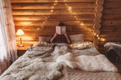 Cozy winter weekend in log cabin stock photos