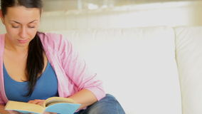 Woman relaxing and reading a book stock footage
