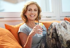 Woman relaxing with a refreshment at outdoors restaurant. Closeup portrait of a happy woman relaxing with a refreshment at outdoors restaurant Stock Photos