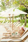 Woman relaxing at resort Stock Image
