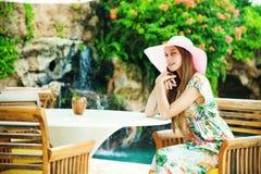 Woman relaxing at resort Stock Photos