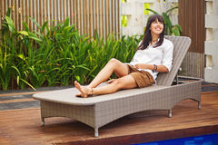 Woman relaxing at resort Royalty Free Stock Photo