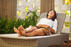 Woman relaxing at resort Royalty Free Stock Images