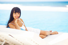 Woman relaxing at resort Royalty Free Stock Photography