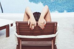 Woman relaxing in resort on a sunbed Royalty Free Stock Image
