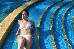 Woman relaxing and resting in spa pool Stock Images