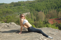 Woman relaxing on rock Royalty Free Stock Image