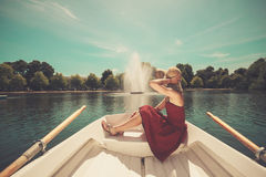 Woman relaxing in a rowing boat on lake Royalty Free Stock Images