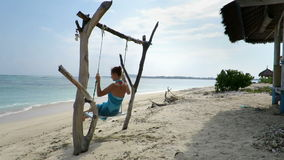 Woman relaxing on rustic swing stock video