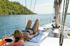 Woman relaxing on Sailboat