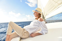 Woman relaxing on sailing boat in the sun Stock Photos