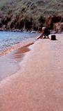 Woman relaxing on sandy beach Royalty Free Stock Image