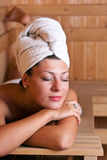 Woman relaxing in the sauna Royalty Free Stock Photos