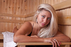 Woman relaxing in the sauna Royalty Free Stock Image