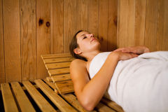 Woman relaxing in a sauna Stock Photos