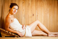 Woman relaxing in a sauna Royalty Free Stock Photography