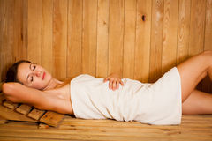 Woman relaxing in a sauna Royalty Free Stock Photos