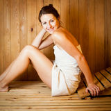 Woman relaxing in a sauna Stock Image