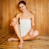 Woman relaxing in a sauna Stock Images