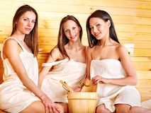 Woman relaxing in sauna. Royalty Free Stock Image