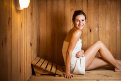 Woman relaxing in a sauna Royalty Free Stock Photo