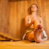 Woman relaxing in a sauna Stock Photo